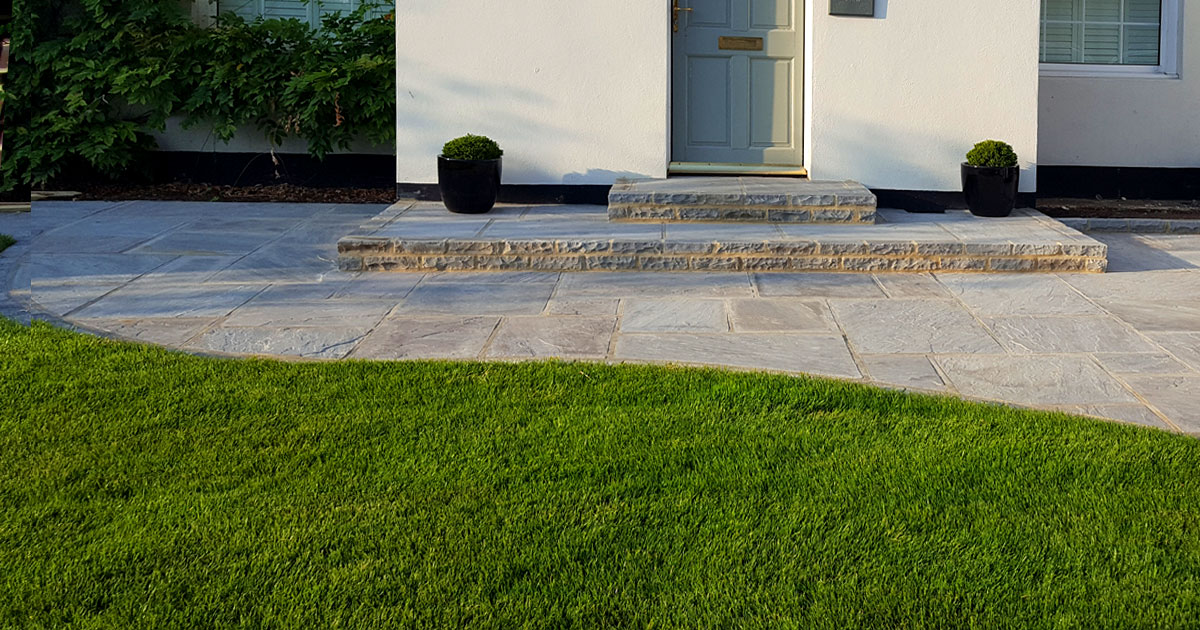 Grey indian stone driveway, brick edging and step