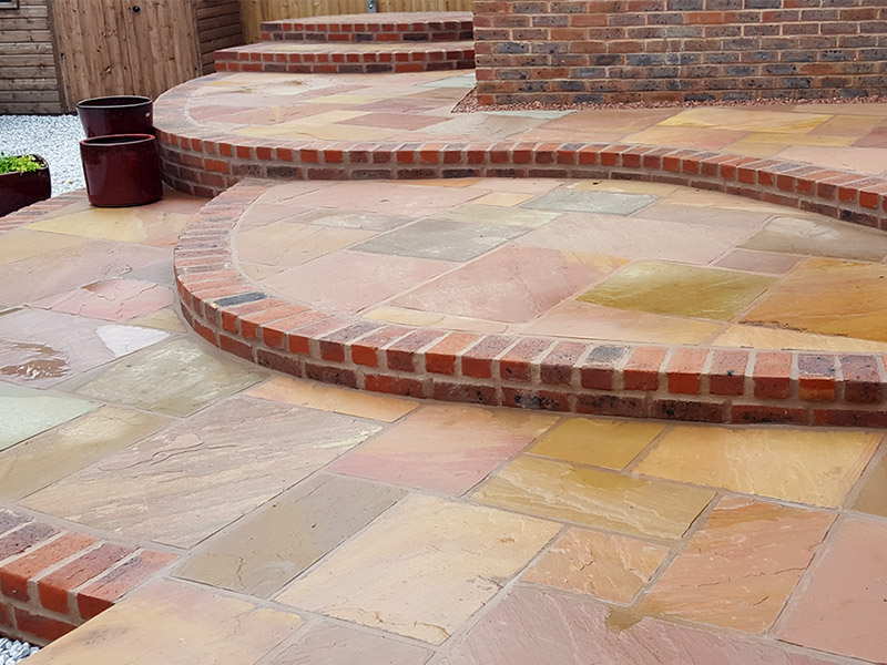 Photo of an Indian stone patio by Shakespeare's Landscapes