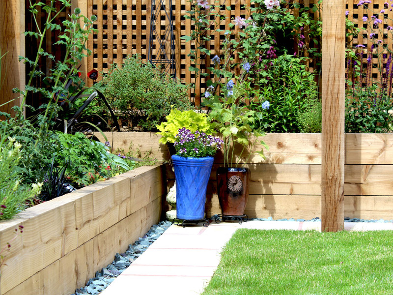 Timber trellis, pergola and raised beds for planting
