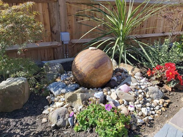 Bespoke rock and pebble water feature