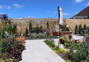 Porcelain paving on paths and patio by Shakespeare's Landscapes